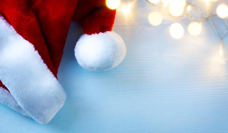 christmas hats: Christmas background with Santa Claus hats  and Christmas tree light
