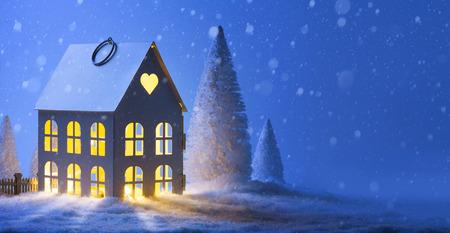 christmas house: House in snowfall. Christmas greeting card; Merry Christmas Landscape