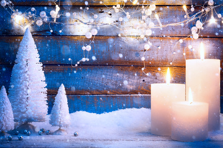 christmas candle: Christmas background with holidays light and Christmas trees Stock Photo