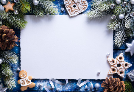 blue border: Christmas background with christmas cookies and festive decoration