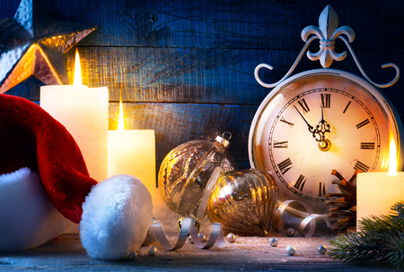 Christmas holiday eve; Christmas decoration and vinyage clock Stock Photo