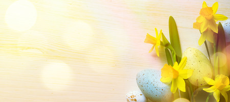 Easter Background with easter eggs and yellow spring flowers Stok Fotoğraf