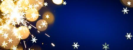 Christmas holidays light on blue background Stock Photo