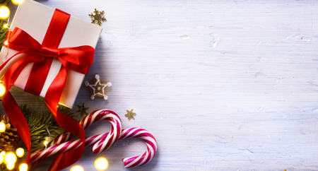 space for text: Christmas holidays composition on white wooden background with Christmas tree decoration and copy space for your text Stock Photo