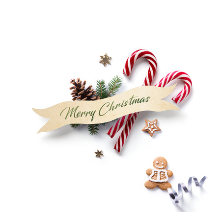 Christmas holiday Decoration element; Christmas ornament with fir tree branches and Christmas candy on white background. Flat lay, top view