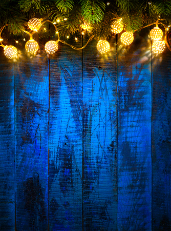 String Light Hanging At Vintage Blue Wooden Background Stock Photo