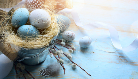 Happy Easter;  Easter eggs on blue table background