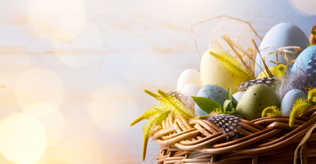 Easter background with Easter eggs in the basket