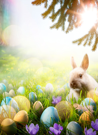 Easter background; Spring flowers  easter bunny and easter eggs