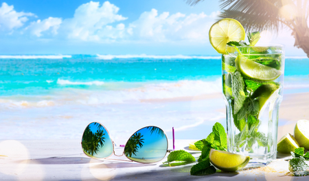 Vacation drims; summer tropical beach wine bar; mojito cocktail drink Stock Photo