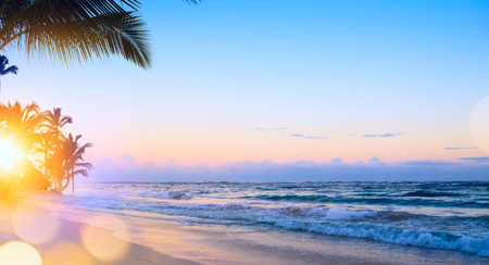 Art summer vacation drims; Beautiful sunrise over the tropical beach  Stock Photo