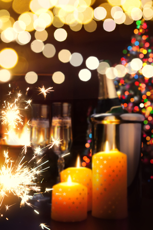 Christmas and happy New year party background; christmas tree, champagne and fireplace.