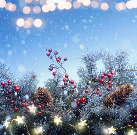 Christmas tree and holidays light decoration on blue snow background Reklamní fotografie