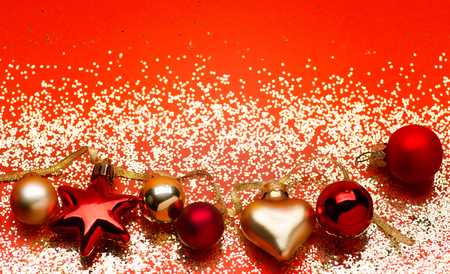 golden lights with christmas tree decoration on red background