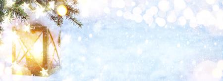 Christmas Lantern On Snowy Fir tree Branch. Winter Decoration Background