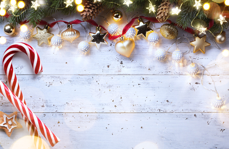 Christmas holidays composition on wooden background; Christmas tree decoration and copy space for your text Reklamní fotografie