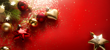 Christmas holidays composition on red background with copy space for your text Reklamní fotografie