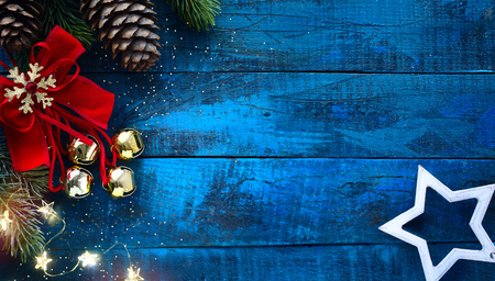 Christmas decoration in vintage style at old blue wooden board Reklamní fotografie