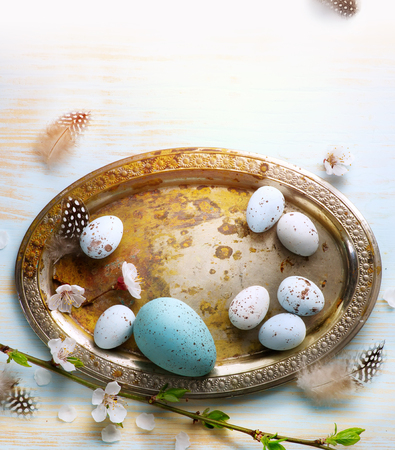 Easter Eggs with Spring Flowers on White Wooden
