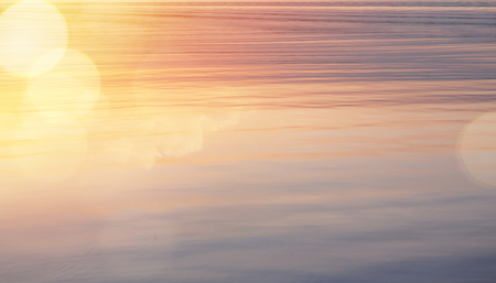 Beautiful abstract shiny light and glitter water sunrise background