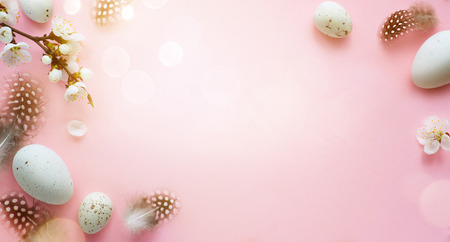 Easter background; Easter Eggs with spring Flowers on pink Background