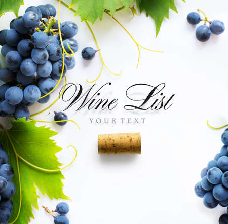 wine list background; sweet black grapes and bottle cork Stockfoto
