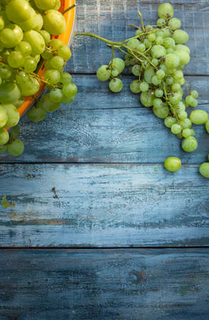 Homemade winemaking background; grape on wooden table