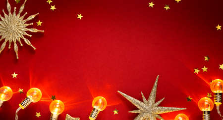 Golden Christmas Tree Decoration And Shiny Holidays Lights On Red Background