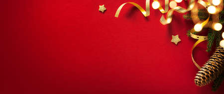 Christmas Tree decoration composition on red background with copy space, banner Stockfoto