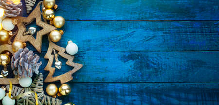 A Blue Christmas banner background with hand-made decoration stars and Christmas tree