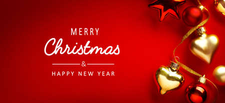 Merry Christmas and happy New Year banner; Christmas Tree Decorations on Red Background