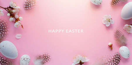Art Happy Easter Holiday banner or greeting card background with Easter eggs and Spring Flowers