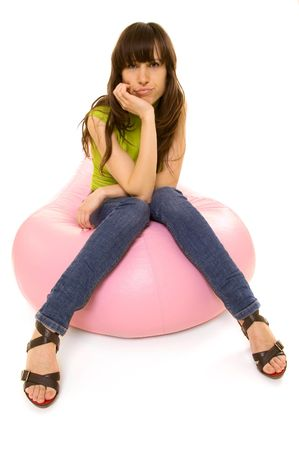 sceptical: sceptical woman sitting on pink chair