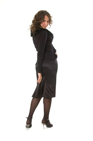 coquette: coquette woman in black looking back Stock Photo