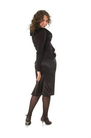 coquete: coquette woman in black looking back Banco de Imagens