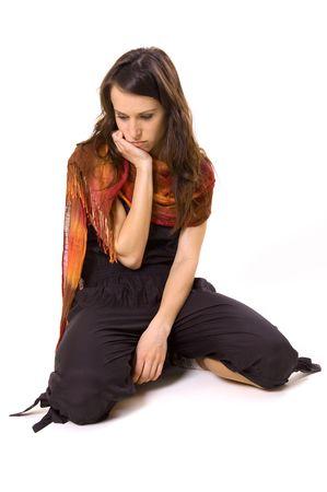 ennui: sad woman sitting on the floor Stock Photo
