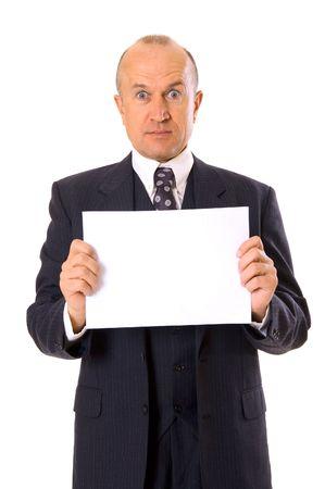 amazed businessman holding your message. isolated on white photo