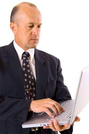 sensible: businessman holding laptop. isolated on white