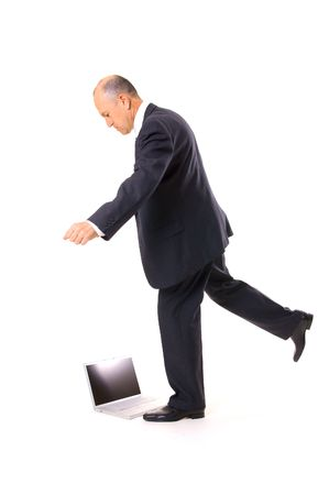 wicked problem: businessman kicking his laptop. isolated on white