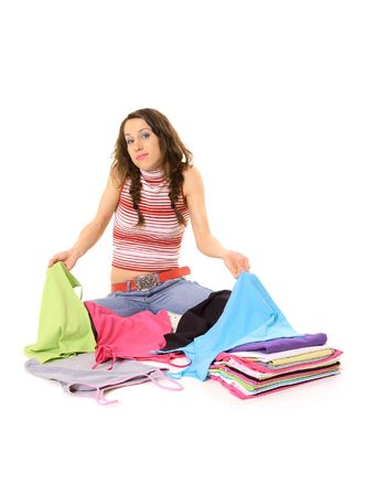 consternation: young woman dont know what t-shirt to wear Stock Photo
