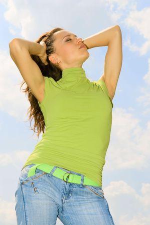 beatitude: beautiful woman against blue sky