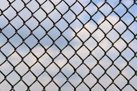 fence of metallic net and blue sky Stock Photo - 3099743