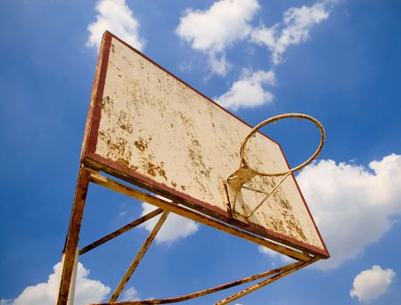 iron hoops: old basketball ring against blue sky