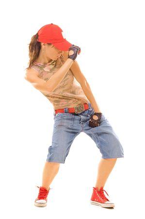 rowdy: atractiva bailarina mirando hacia abajo en la danza. aislados en blanco