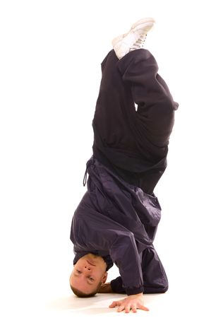 roughneck: cool dancer standing on the head. isolated on white Stock Photo