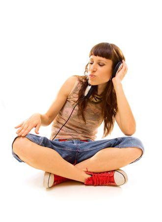 dj in headphones sitting on the floor. isolated on white photo
