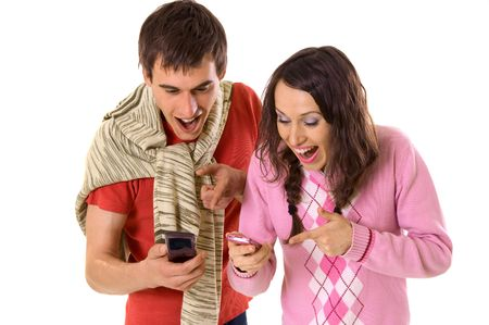 happy man and woman pointing at mobile photo