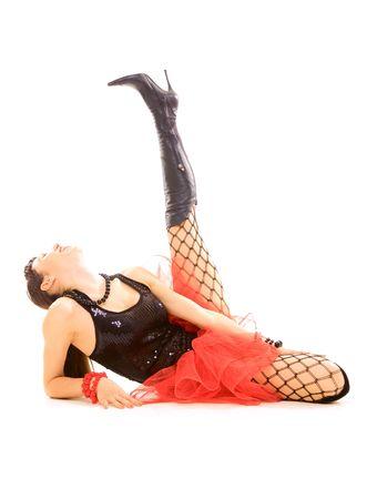 happy woman lying on the floor and raise her leg photo