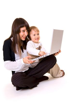 computer instruction: happy family sitting with laptop. isolated on white