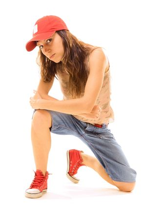 squatter: tomboy sitting on the floor. isolated on white Stock Photo